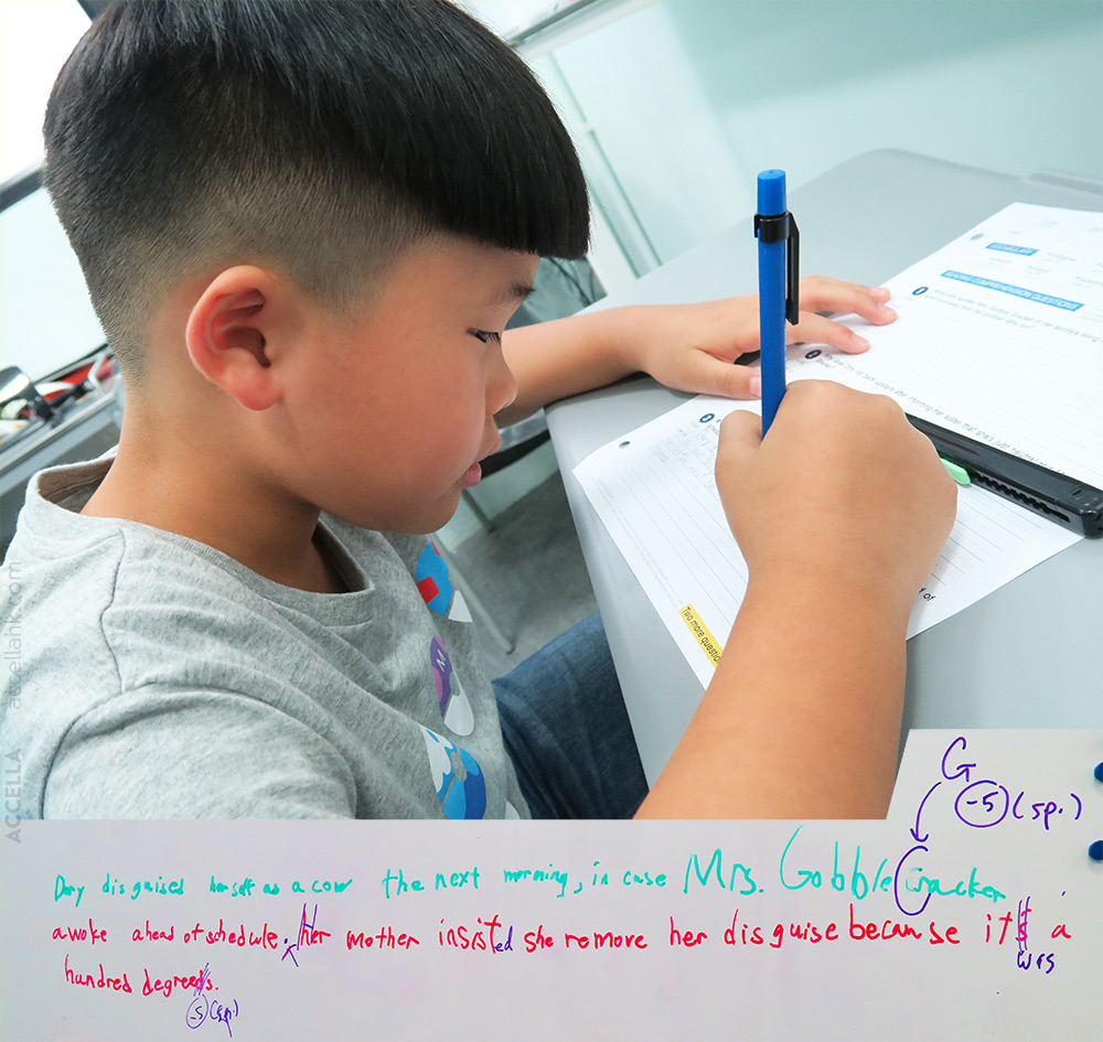 Wilfred K. editing his answer to the third question from this week's reading comprehension homework.