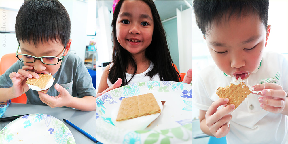 Isaac, Quincy, and Sze-Shing chowed down, for the first time, on s'mores!