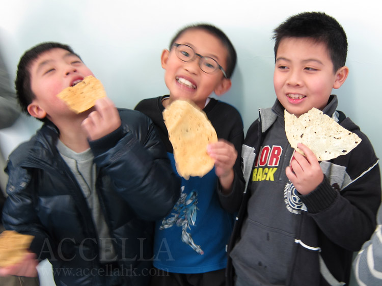 WilsonW, MordecaiL, and AngusL (from left to right) taking bites out of their poppadoms munching on a poppadom.