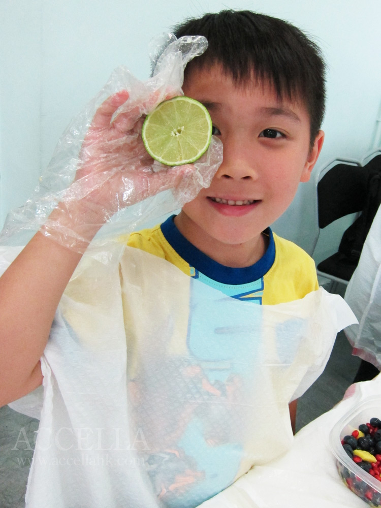 JamesF holding half of one of the limes that each student juiced for their dressing.