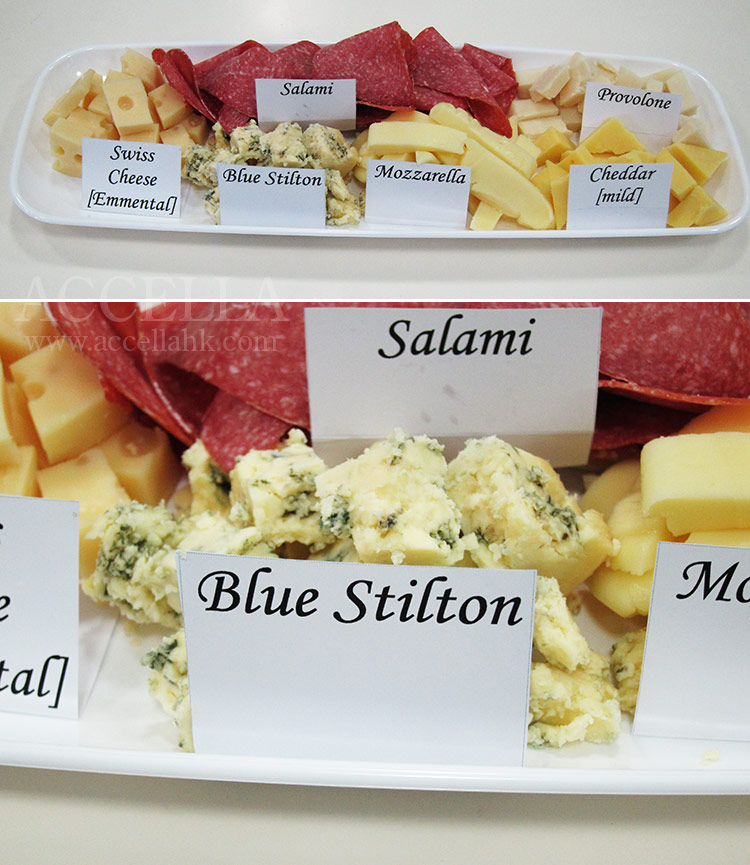 All of the kinds of cheese mentioned in 'The Enormouse Pearl Heist', as well as salami (also mentioned), clockwise from center: salami, provolone, cheddar, mozzarella, [Blue] Stilton, and Swiss (Emmental to be precise).